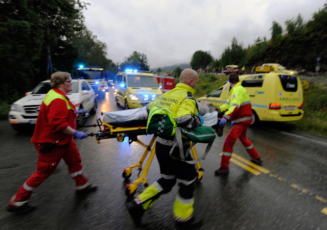 Rescue personnel push an injured victim away from the camp site of in Uoteya, where a gunman dressed in police uniform killed at least 85 people on July 23, 2011. (REUTERS/Morten Edvardsen/Scanpix)